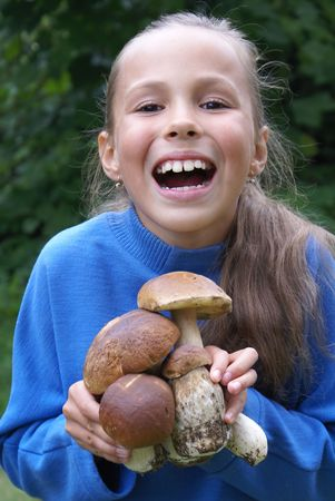 beautiful preteen girl: Cheerful preteen girl with mushrooms