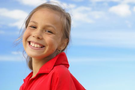 preteens beach: Cheerful preteen girl on blue sky background