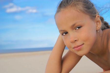 petite girl: Preteen girl on a beach