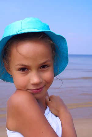 Cheerful preteen girl on a beach Stock Photo - 3913684