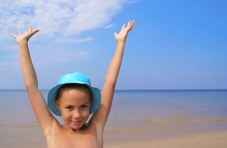 Preteen girl on a beach on blue background Stock Photo - 3913682