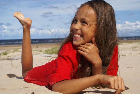 Preteen girl on a beach