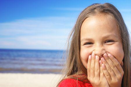 Cheerful preteen girl on a beach Фото со стока - 3921844