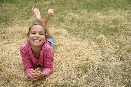 Smiling preteen girl resting on grass Stock Photo - 3969189