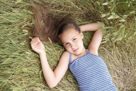 Smiling preteen girl resting on grass Фото со стока - 4746633