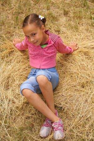 Smiling preteen girl resting on grass 스톡 콘텐츠 - 5079452
