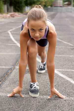 cute little girls: Preteen girl starting to run on track