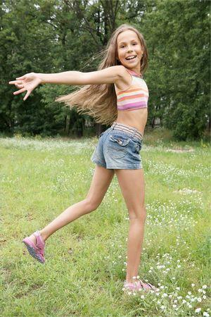 petite girl: Happy preteen girl running outdoors