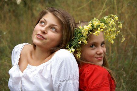 Cheerful happy girls playing outdoors Фото со стока - 5495315