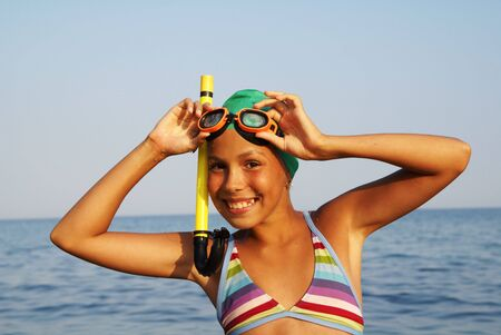 preteens beach: Preteen girl in diving outfit enjoying sun-bath on sea beach Stock Photo