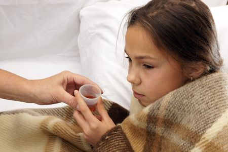 cold and flu: Sick preteen girl takes medicine
