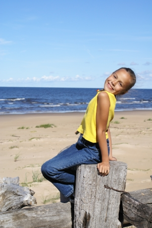 preteen: Preteen girl on a beach of Baltic sea Stock Photo