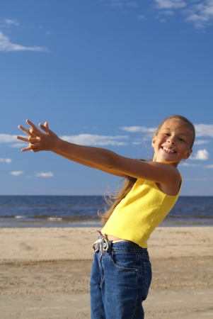 Preteen girl on a beach photo