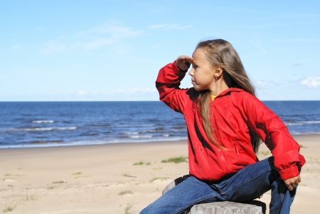 blue jeans kids: Preteen girl on a beach of Baltic sea Stock Photo