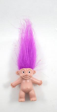 troll dolls: Little mini troll doll with bright purple hair Editorial