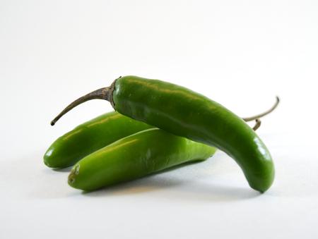 capsicum: Spicy green serrano pepper (capsicum anuum) - isolated Stock Photo