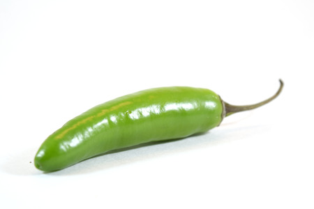 ouch: Spicy green serrano pepper (capsicum anuum) - isolated Stock Photo