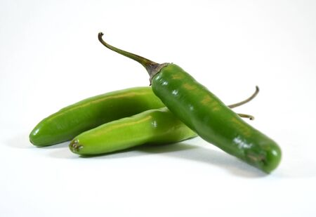 capsaicin: Spicy green serrano pepper (capsicum anuum) - isolated Stock Photo