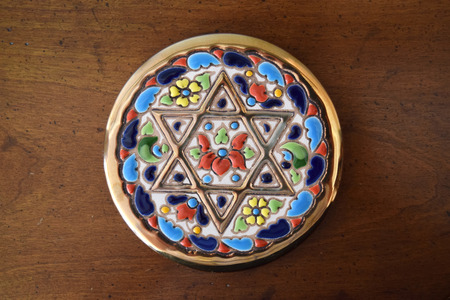 jewish star: Decorative coaster with golden Jewish Star of David inlay