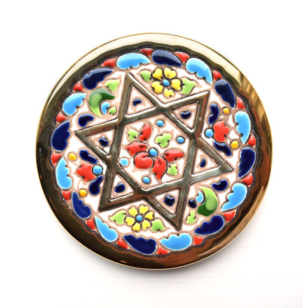 jewish star: Decorative coaster with golden Jewish Star of David inlay, isolated