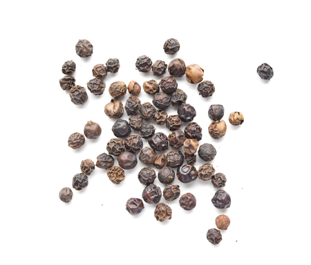 indian cookery: Black peppercorns, macro, isolated
