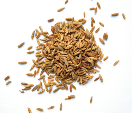 sopa: Cumin (cuminum cyminum from apiaceae family) in a pile, isolated on white background