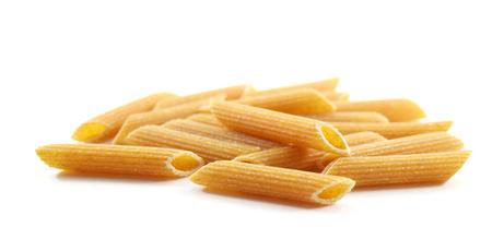 ridged: Pile of ridged organic whole wheat penne pasta - isolated