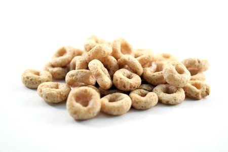 os: Whole weat circular cereal Os on white background
