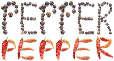 compilation: Compilation of peppercorns and dried cayenne peppers spelling out the word PEPPER - isolated