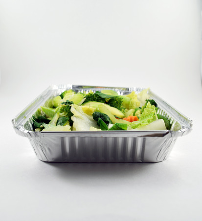 takeout: Steamed vegetables in metal takeout tray Stock Photo