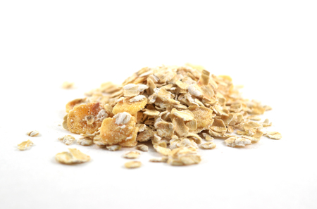 Pile of instant oatmeal, apple and cinammon flavor - isolated