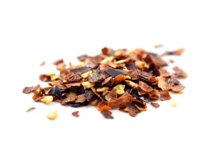 crushed red peppers: Dried crushed red pepper - isolated Stock Photo