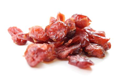 arandanos rojos: Sweetened dried cranberries, isolated Foto de archivo