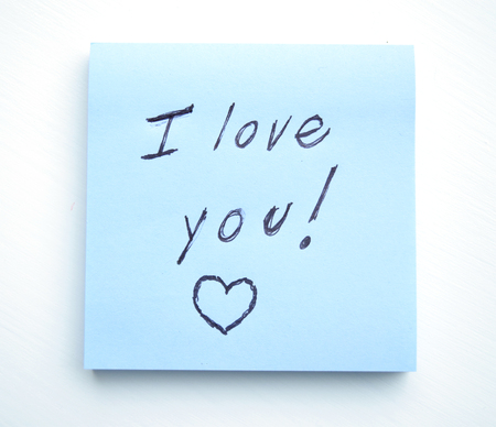 Sticky note pad with the phrase I love you! written on it Stock Photo