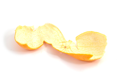 clementine fruit: Peeled skin of clementine fruit - isolated, white background