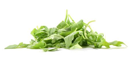 Heap of organic arugula or rocket - isolated