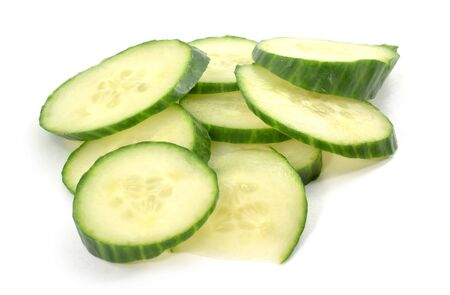 Pile of cucumber slices - isolated, white background