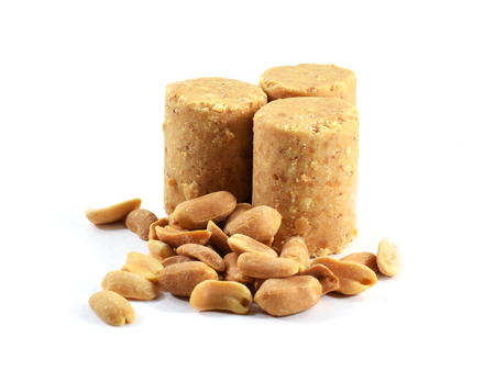 Pacoca, Brazilian peanut candy eaten during Festa Junina, June Festival with roasted peanuts - isolated Stock Photo