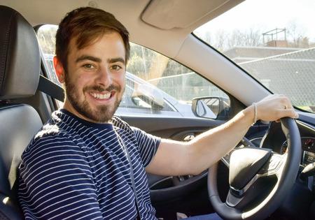 Handsome man hand on steering wheel driving car