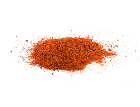 Pile of sweet Hungarian ground paprika powder - isolated