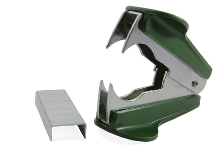 clincher: Darkly green staple remover and staples on a white background