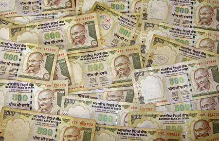 indian money: A scattering of 500 ruppee notes