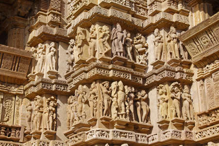 Exterior carvings on the Hindu temples at Khajuraho in India photo