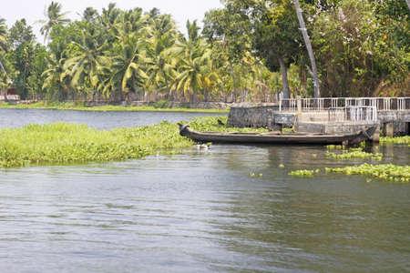 backwaters: Abandoned canoe on the Keralan backwaters