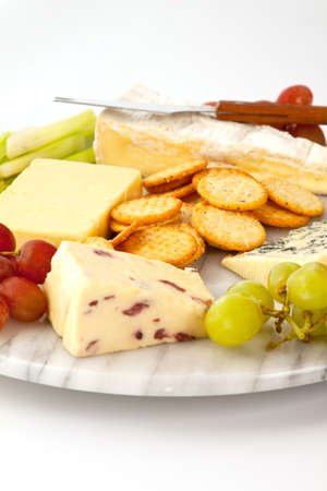cheeseboard: Selection of cheeses with biscuits and garnish on a marble cheeseboard