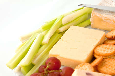 plateau de fromage: Close up of a variety of cheese and garnishes on a marble cheeseboard