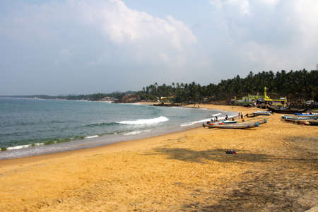 View along the beach at Kovalum in Kerala, Southern India photo