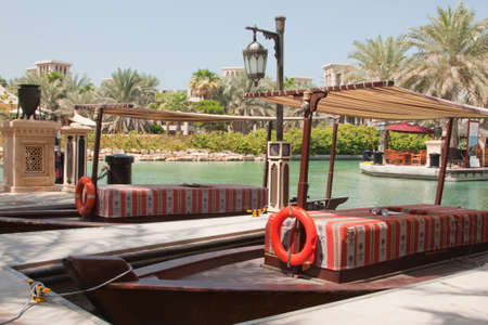 Water taxis on the canals of the Madinet Jumeirah hotel in Dubai photo