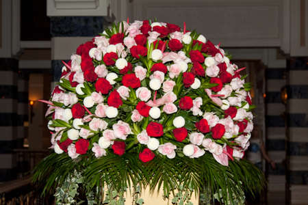 Centrepiece: Floral centrepiece composed of red, pink and white flowers