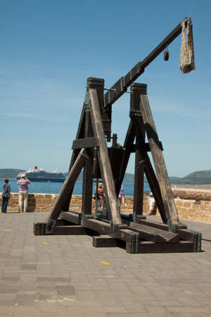 appears: An ancient trebuchet appears to be targeting a cruise liner Stock Photo